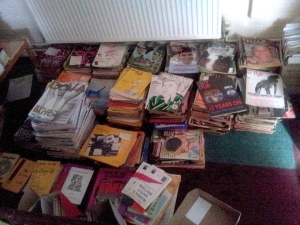 Some of the many donated magazines waiting to be archived